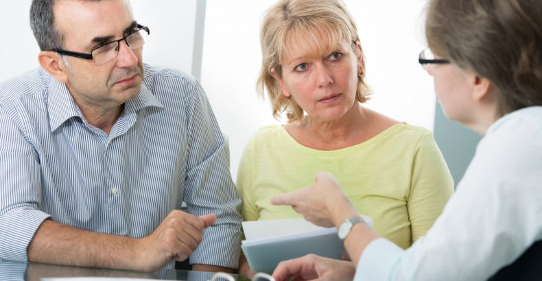 customers in a meeting with insurance agent