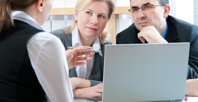insurance agent meets with clients
