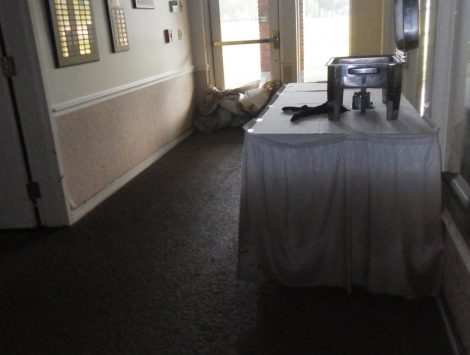 water damage restoration golf course hallway before