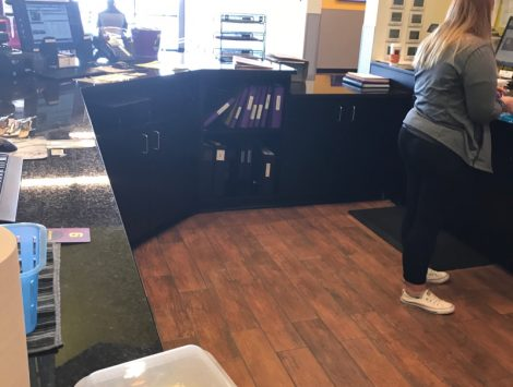clean up of frozen pipe burst water damage behind counter